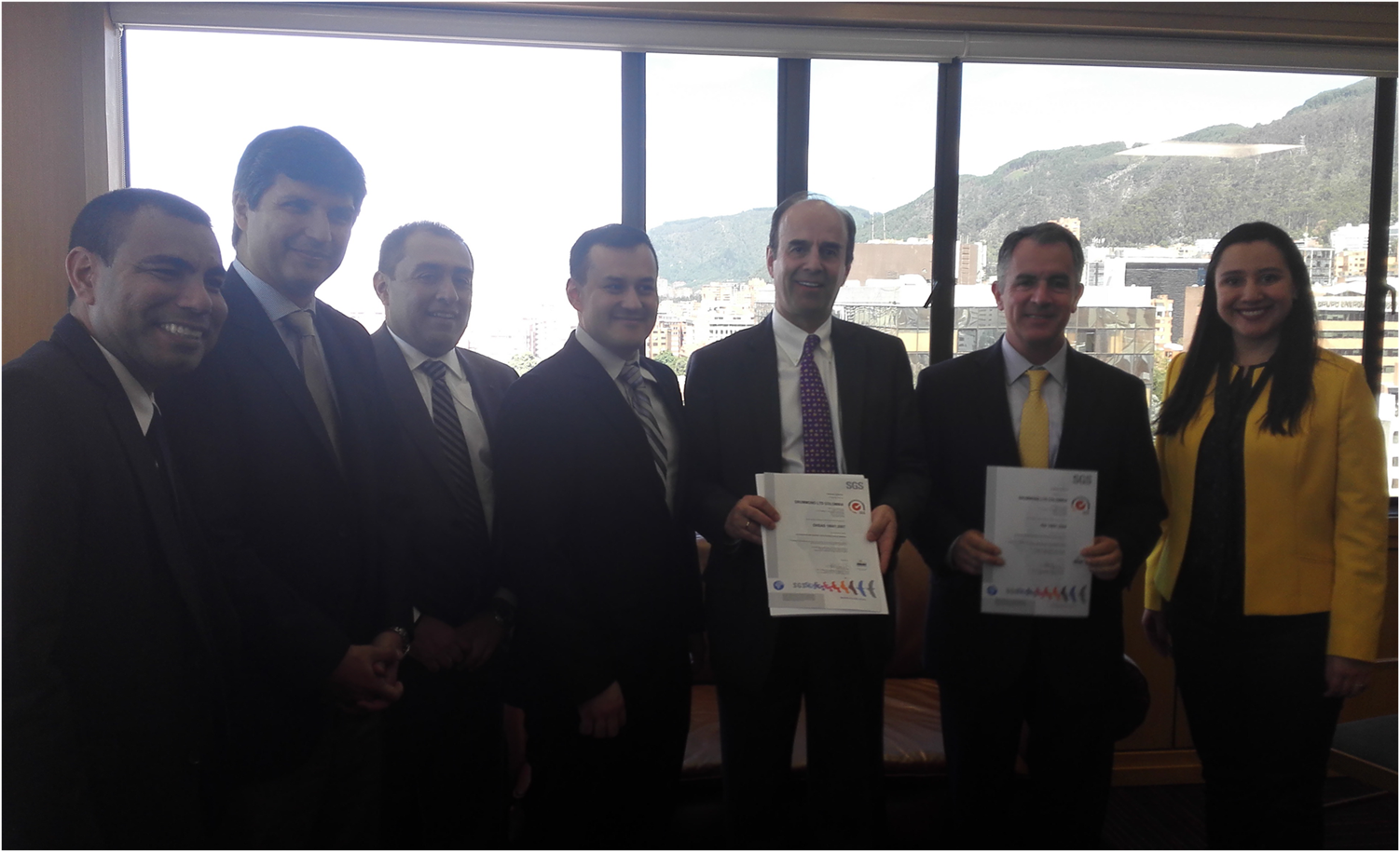 Jose Miguel Linares, President of Drummond Ltd. and Alfonso Rubiano, Planning and Development Manager of the company's Hydrocarbons Division, received the ISO 14001 and OHSAS 18001 certificates from Ivan Dominguez and his team at SGS.