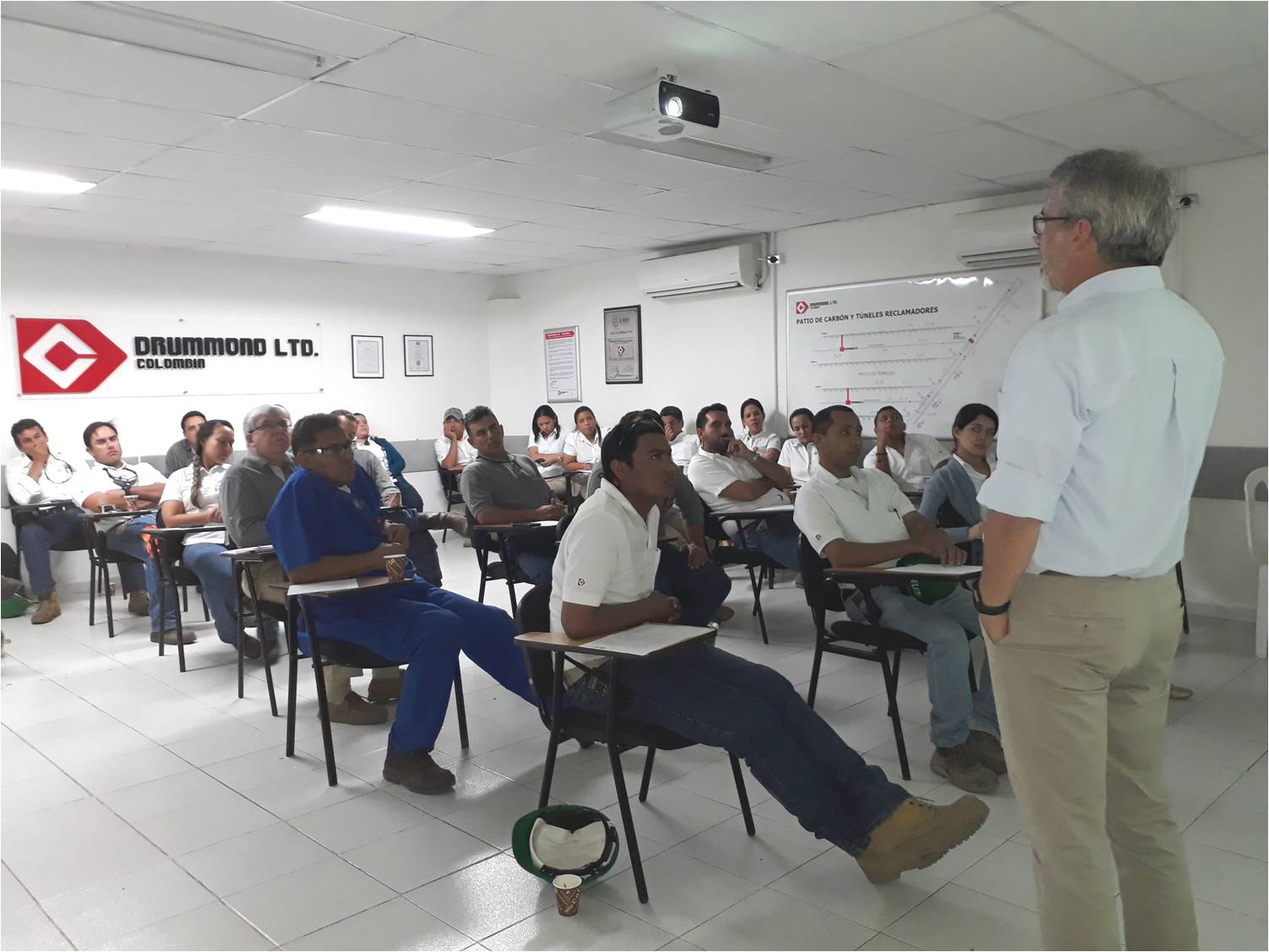 Drummond Ltd. employees receiving training from José Rafael Unda, manager of Ardura S.A.S., a company with expertise in human rights.